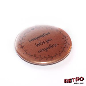 magnet-btn-59-rund-imagination-takes-you-erverywhere-persp-bronze